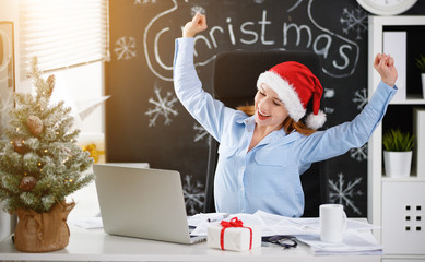 businesswoman freelancer working at a computer at Christmas