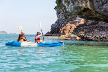 Two women are mother and daughter. Travel by boat with a kayak happy at summer around Ko Phi view the beautiful nature of the sea and island, Mu Ko Ang Thong National Park, Surat Thani, Thailand