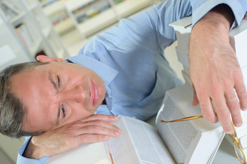 Man layed on a book
