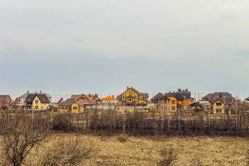 Suburban skyline. Buildings individual suburban housing in early spring. Belgorod Region, Russia.