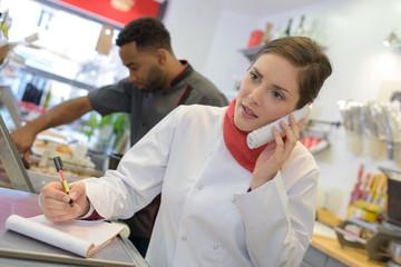 Female chef on telephone