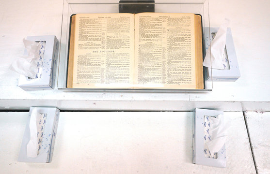 A Bible open to the book of Proverbs is seen at the First Baptist Church of Sutherland Springs where 26 people were killed one week ago, as the church opens to the public as a memorial to those killed