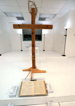 A cross with a crown of thorns and a Bible open to the book of Proverbs are seen at the First Baptist Church of Sutherland Springs where 26 people were killed one week ago, as the church opens to the public as a memorial to those killed