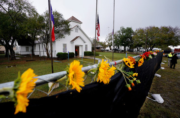Flowers decorate the fence around the First Baptist Church of Sutherland Springs where 26 people were killed one week ago, as the church opens to the public as a memorial to those killed