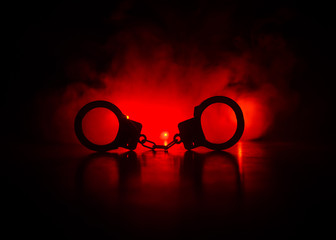 handcuff or shackle on black background. Silhouette of shackle on dark background