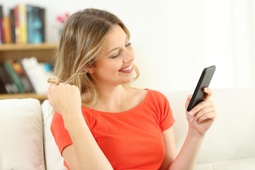 Candid woman flirting dating on line with a phone