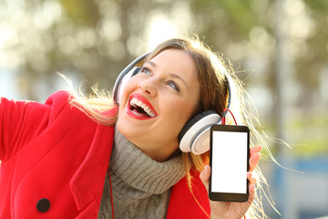 Girl listening to music and showing smartphone screen