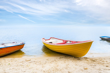Rowboats moored on the beach
