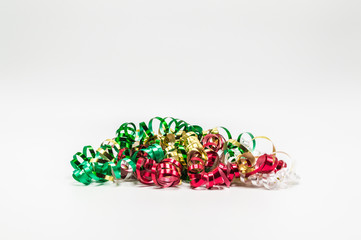 pile of colorful Christmas curling ribbon isolated on a plain background