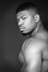 tough African American body builder portrait black and white