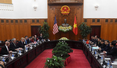 U.S. President Donald Trump and Vietnam's Prime Minister Nguyen Xuan Phuc talk at the Government Office in Hanoi