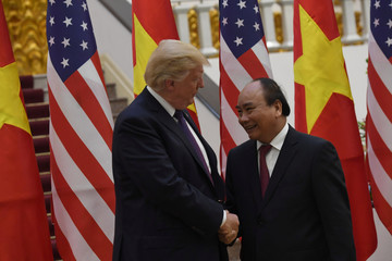U.S. President Donald Trump poses for a photo with Vietnam's Prime Minister Nguyen Xuan Phuc at the Government Office in Hanoi