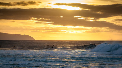 Scenic seascape sunset at Banzai Pipeline beach on North Shore of Oahu, Hawaii, USA.