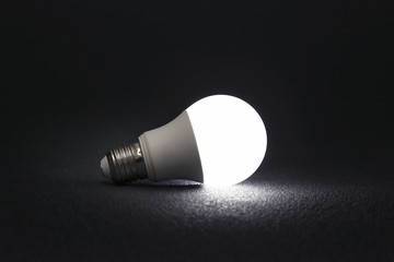 modern led lamp is turned on a dark background.