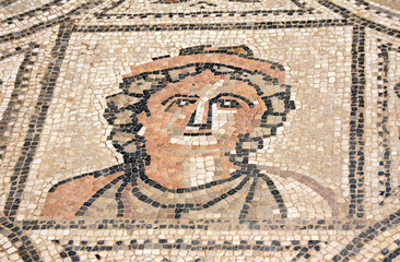 Ancient mosaic with woman face, Volubilis, Morocco