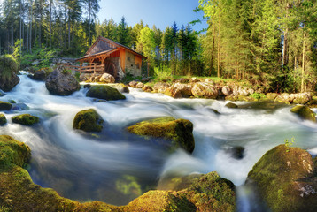 Austria panorama landscape with waterfall and watermill near Salzburg, Golling Alps