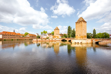 Landscape view on Petite-France region with beautiful ancient towers and bridge in Strasbourg city, France