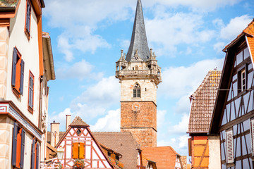 Cityscape view on the old village with medieval tower in Obernai town in Alsace region, France