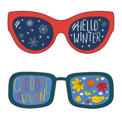 Hand drawn vector illustration of glasses with text Hello Winter, Goodbye Autumn, leaves, snowflakes reflected in the lenses. Isolated objects on white background. Design concept for change of seasons