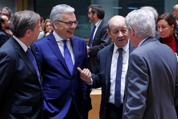Slovenia's Foreign Minister Erjavec, Belgian Foreign Minister Reynders, French Foreign Affairs Minister Le Drian and their Spanish counterpart Quecedo attend a EU foreign ministers' meeting in Brussels