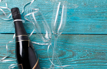 Image of two wineglasses, bottle of champagne, white ribbons
