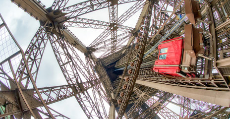 Fototapete - Powerful structure of Eiffel Tower, wide angle view