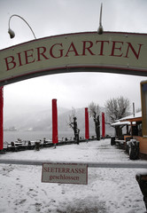 """A sign """"lake terrace closed"""" is seen at a beer garden after snow fall in Schliersee"""