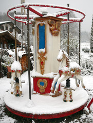 A children's merry-go-round is seen at a beer garden after snow fall in Schliersee