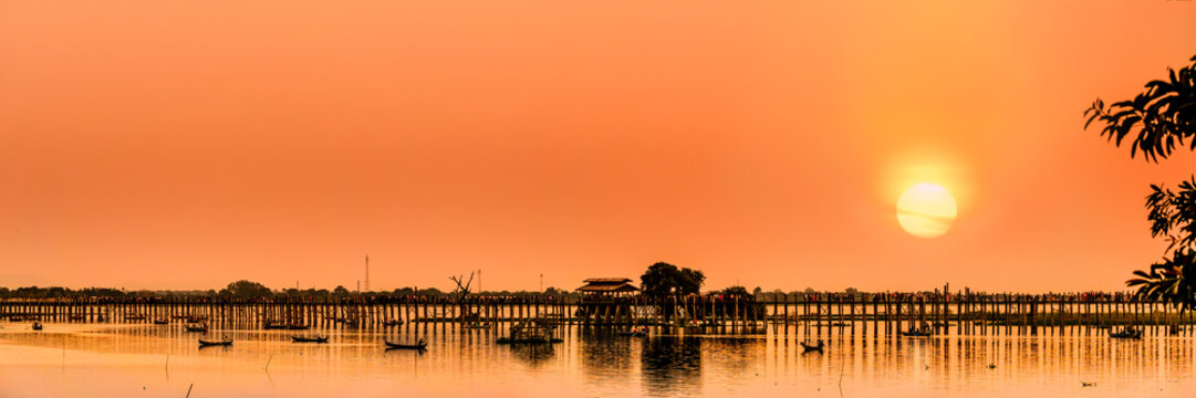 The silhouette of U Bein Bridge, the oldest and longest teakwood bridge in the world across the Taungthaman Lake, Amarapura, Myanmar