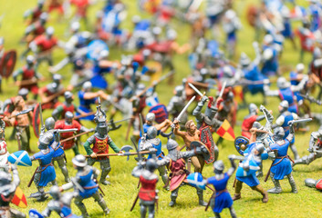 Plastic toy soldiers engaged in a battle - War concept