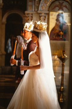 newlyweds wedding ceremony in the church,wedding ceremony, glans