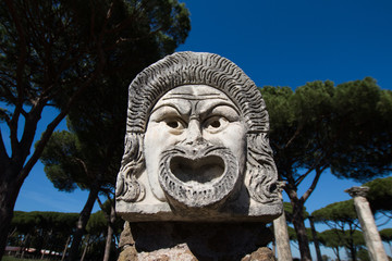 Marble Mask decoration in Ostia Antica theatre. 1st century mask in the proscenium of Ostia antica, part of architectonic decoration
