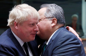 Britain's Foreign Secretary Boris Johnson and Greek Foreign Minister Nikos Kotzias attend a European Union foreign ministers' meeting in Brussels
