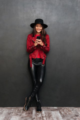 Smiling young beautiful woman chatting by mobile phone.