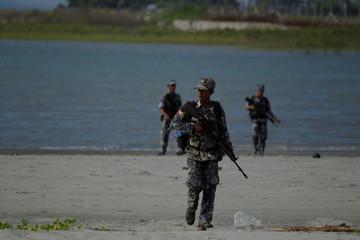 Myanmar border guard police force patrol near the Myanmar-Bangladeshi border outside Maungdaw