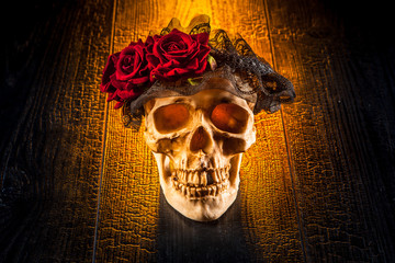 A skull with a wreath of roses. Roses on the skull.