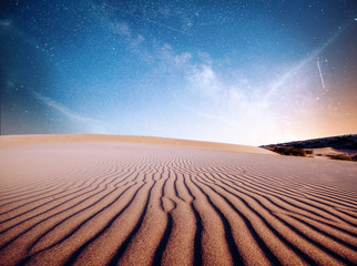 Desert sand dunes in night, stars and milky way, deep sky astrophoto