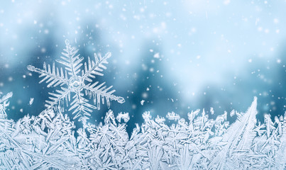 Christmas background - snowflake on window