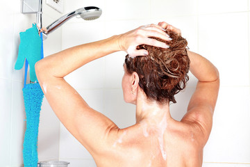 Closeup shot of woman washing her hair in a shower