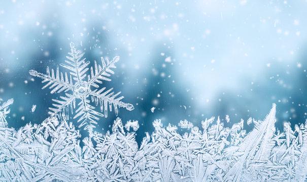 Christmas background - snowflake on window