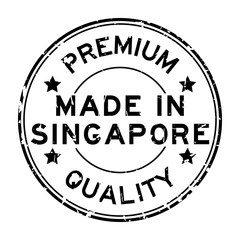 Grunge black premium quality made in Singapore round rubber business seal stamp on white background