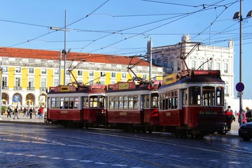 Colorful trams through the streets of Lisbon in Autumn
