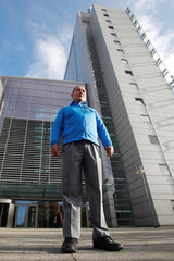 Peruvian farmer and mountain guide Saul Luciano Lliuya poses for pictures in front of the high regional court of Hamm before taking RWE to court