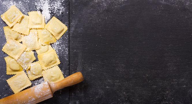fresh ravioli on dark board