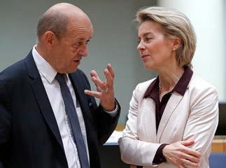 French Foreign Affairs Minister Le Drian and German Defence Minister von der Leyen attend an European Union foreign and defence ministers' meeting in Brussels