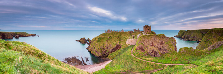 Dunnottar Castle Panorama / Dunnottar Castle is a ruined medieval fortress located upon a rocky headland on the north east coast of Scotland, near Stonehaven