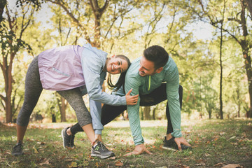 Young couple stretching after outside running.