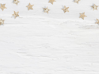 Christmas mockup scene little wooden stars made of birch bark on white grunge background. Empty space for your text, top view flat lay photography.