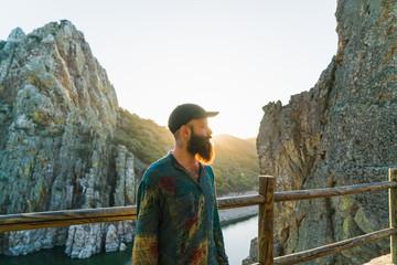 Confident man on rocky terrace