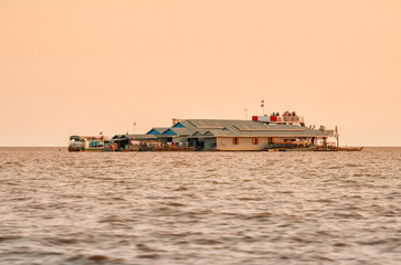 Tourists in floating village on Lake Tonle Sap